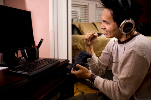 istock Asian Young Man Gamer Using PC at Home, Copy Space 172271357
