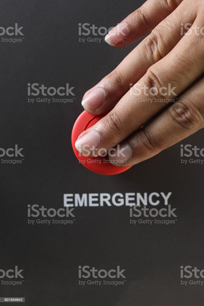 Asian Male hand pushing emergency red button. stock photo
