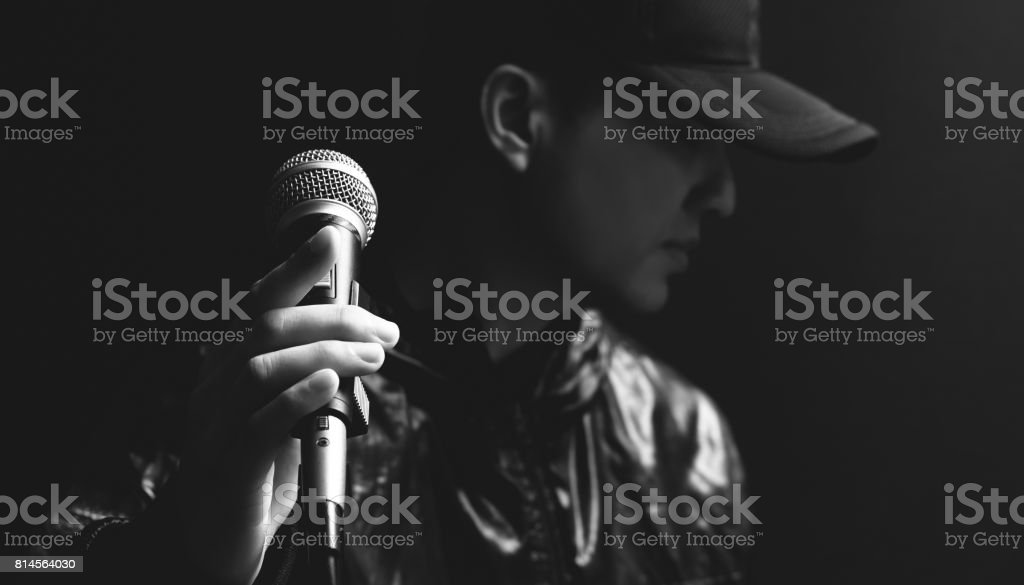 asian male singer hands on microphone stock photo