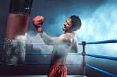 istock Asian man boxer practicing with punching bag 623823482