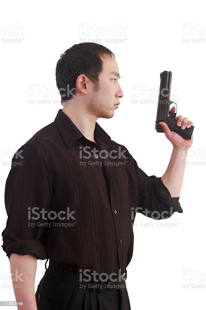 Asian Man Brandishing Pistol stock photo