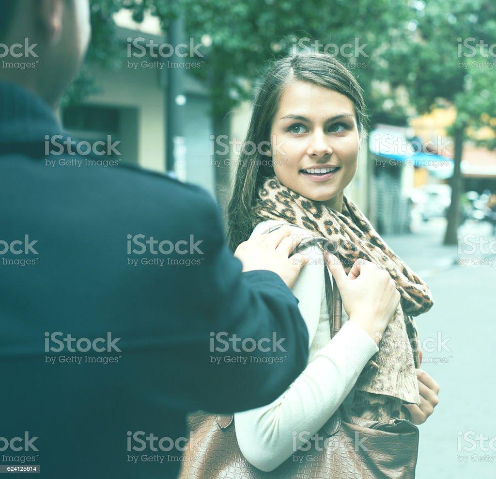 Asian man chasing smiling girl stock photo