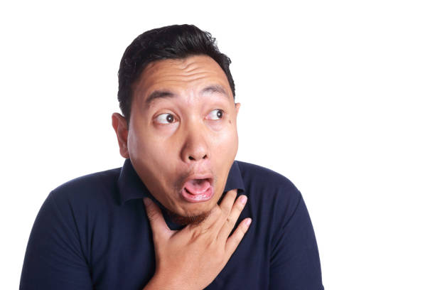 Asian Man Chocked with Tongue Out stock photo