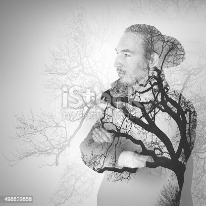 istock Asian man combined with bare tree landscape 498829858
