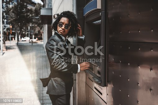 istock Asian man entrepreneur using an automated teller machine 1076115600