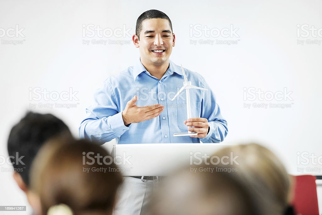 Asian man giving a public speech on solar energy royalty-free stock photo