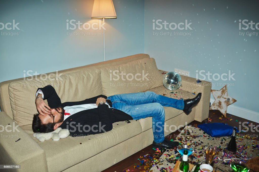 Asian man having hangover after party stock photo