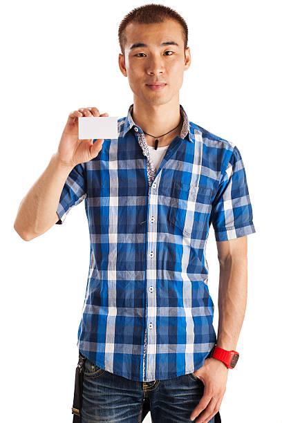 asiatischen mann hält business-karte - marko skrbic stock-fotos und bilder