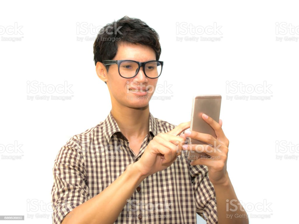 Asian man in scott pattern shirt using phone. royalty-free stock photo