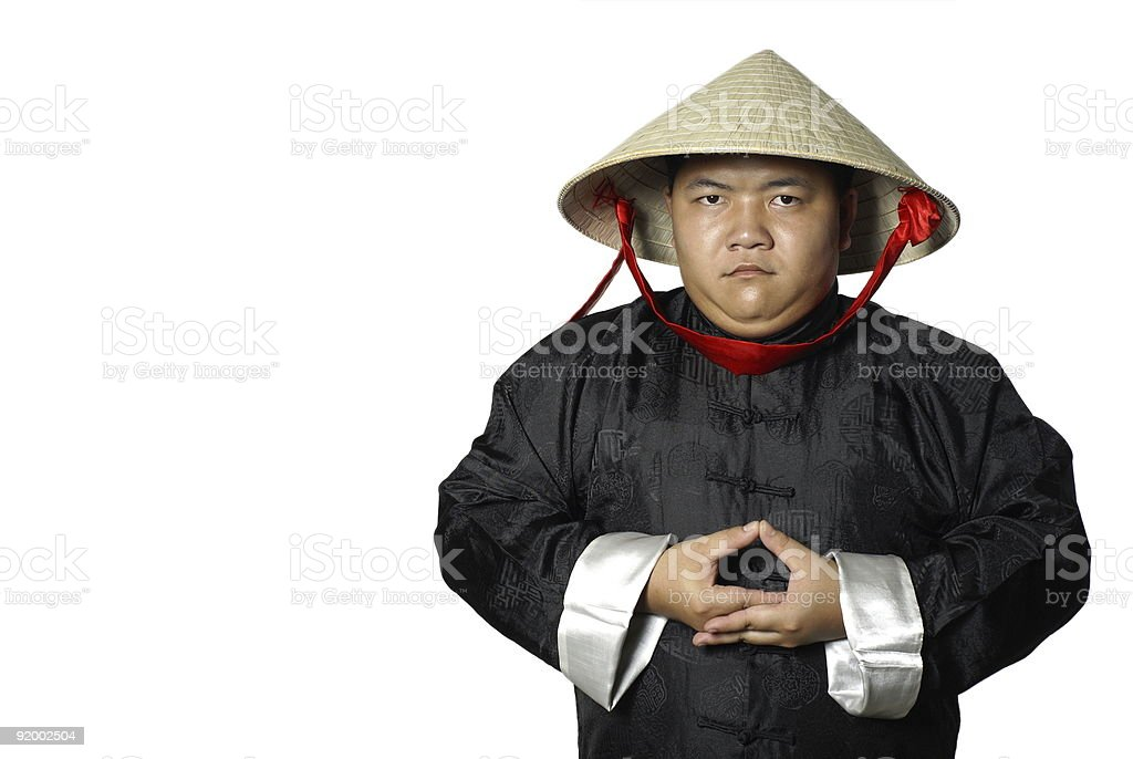 Asian man in traditional chinese costume meditating stock photo