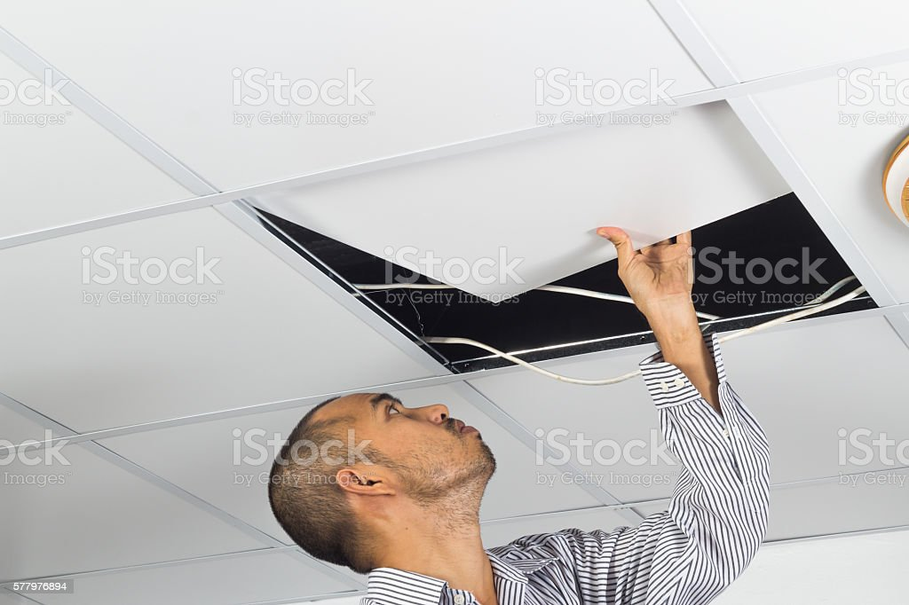 Asian man install suspended ceiling – Foto