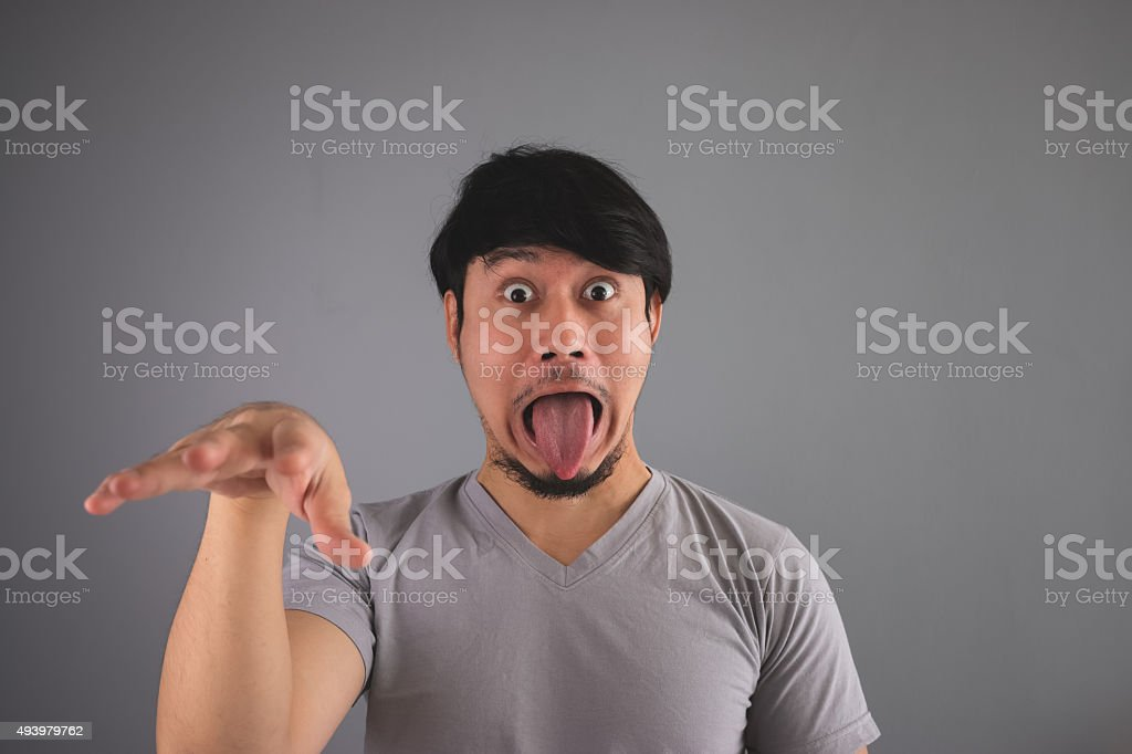 Asian man is making funny scary face. stock photo