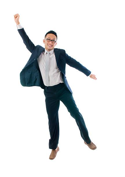 asian man jumping in joy stock photo