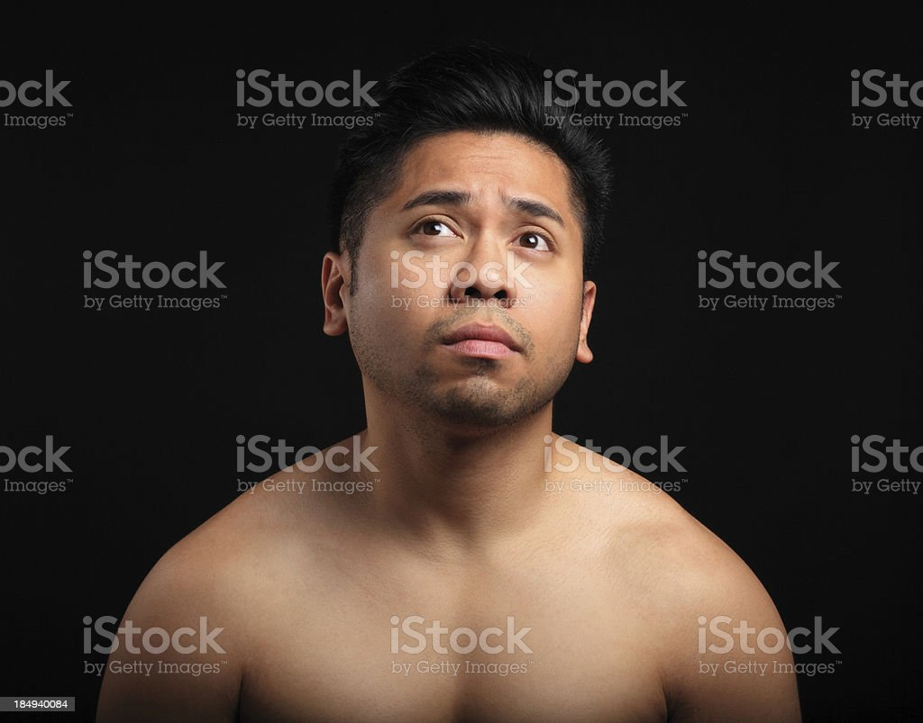 Asian man looking up stock photo