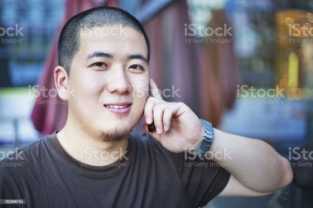 Asian man on the phone royalty-free stock photo