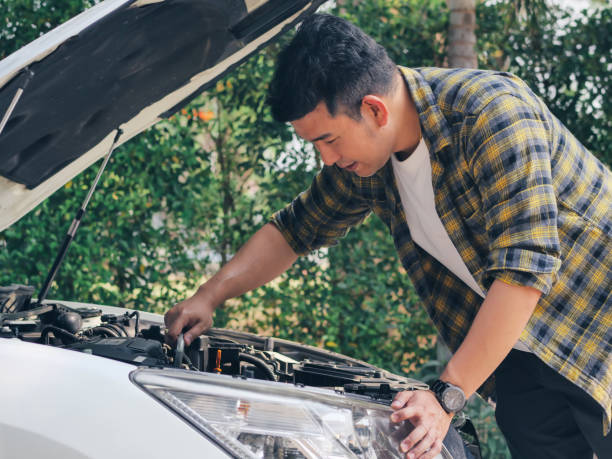 Asian man open car hood and check up his car, lifestyle concept. Asian man open car hood and check up his car, lifestyle concept. vehicle hood stock pictures, royalty-free photos & images