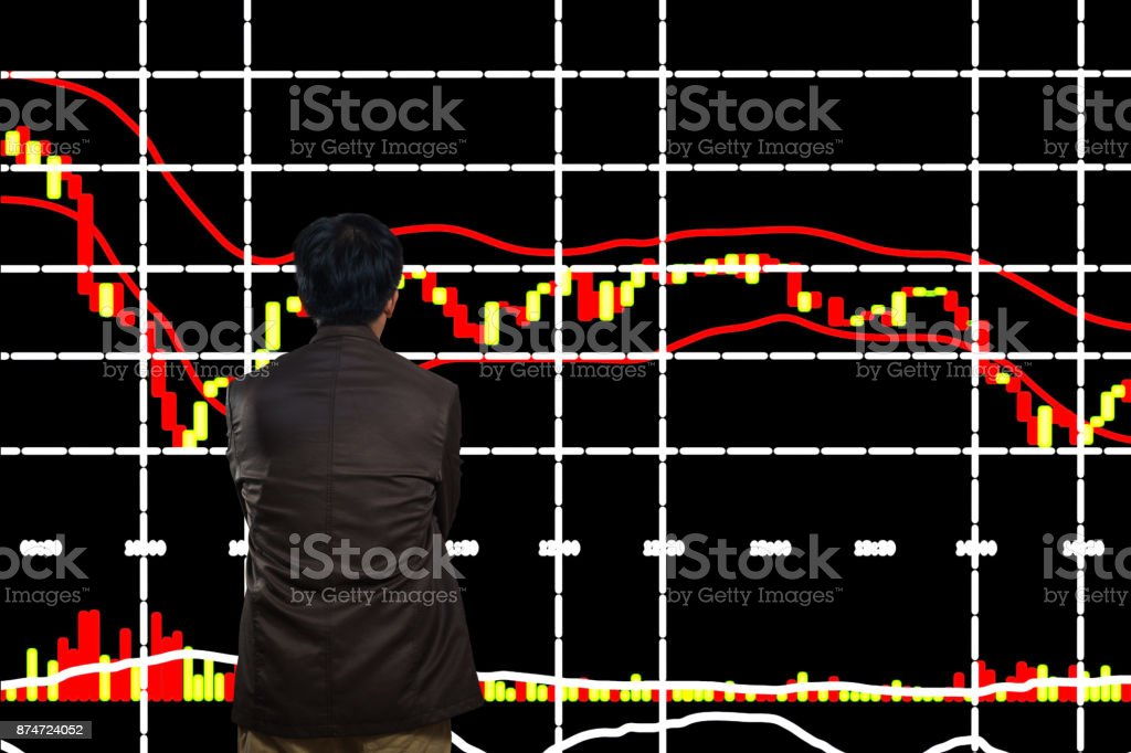 Asian Man or Male Looking at Stock Trading data Chart on Display Board stock photo