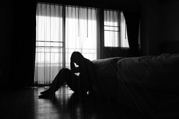 Asian man Silhouette of depressed man sitting in the private room suicide stock pictures, royalty-free photos & images