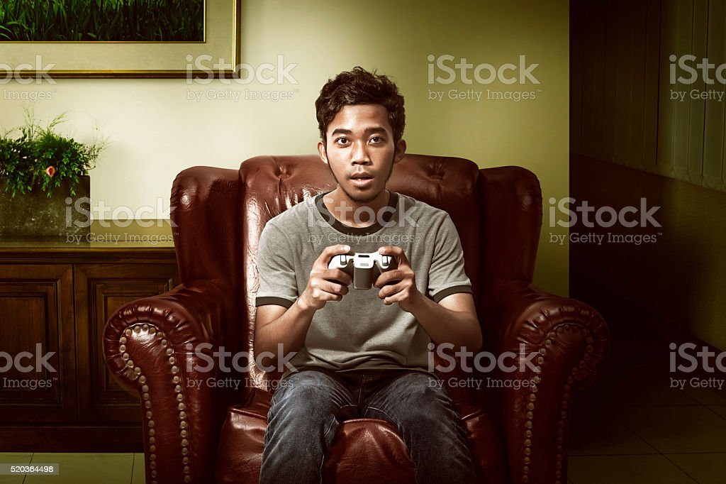 Asian man playing game stock photo