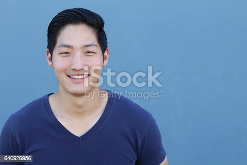 689644378istockphoto Asian Man Portrait Smiling Isolated 640926956