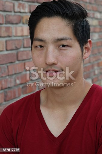 689644378istockphoto Asian Man Portrait Smiling Isolated 657517776