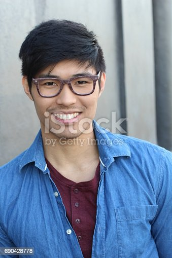 689644378istockphoto Asian Man Portrait Smiling Isolated 690428778