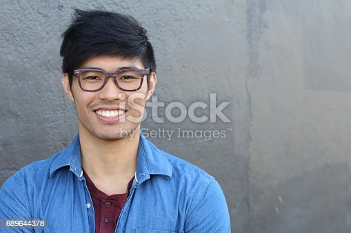 istock Asian Man Portrait Smiling Isolated with copyspace 689644378