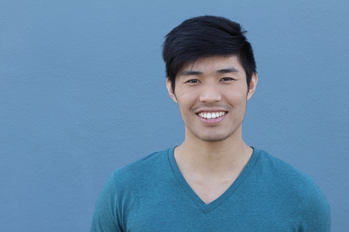 689644378 istock photo Asian Man Portrait Smiling Isolated with CopySpace 689644762
