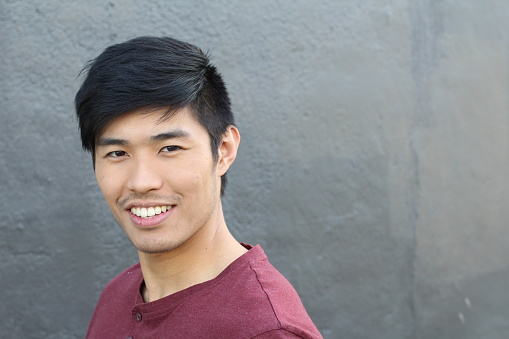 689644378 istock photo Asian Man Portrait Smiling Isolated with CopySpace 690428902