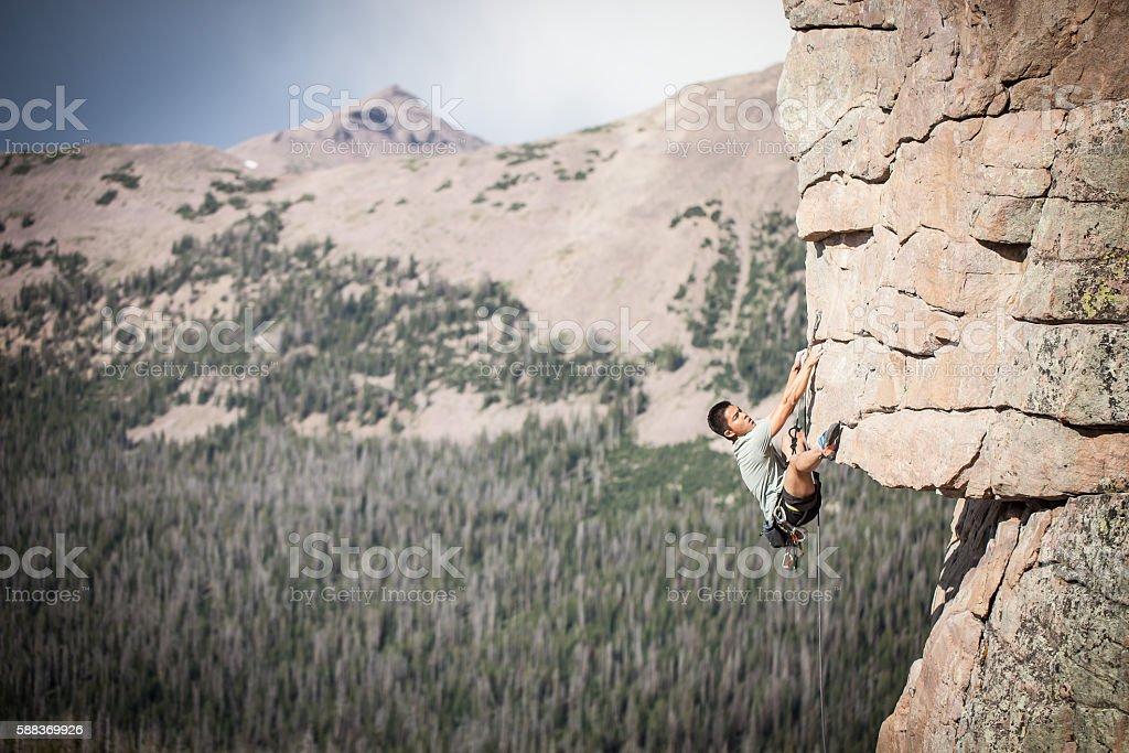 Asian Man Rock Climbing stock photo