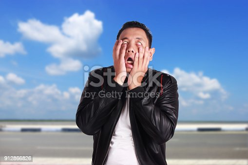 istock Asian Man Showing Tired Lazy Annoyed Expression 912866826