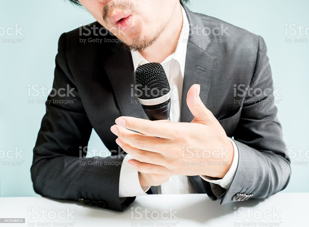 Asian man snapping back stock photo
