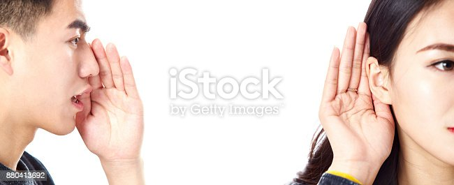 istock asian man speaking woman listening 880413692
