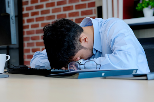 Asian Man Stress At Work Frustrated Young Asia Businessman Take A Break  From Working With Computer At Office Desk Office Male Exhausted And Take A  Nap From Depressed Work Business People Struggle