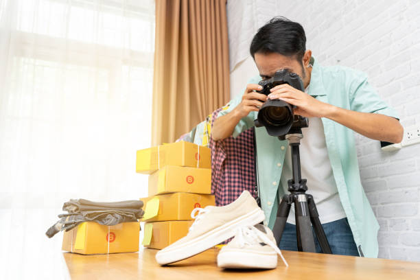 Asian man taking photo to shoes with digital camera for post to on picture id1169061249?b=1&k=6&m=1169061249&s=612x612&w=0&h=4cp9p1mzfgcgi2ykhmfdjg27n9w4g848uw2j3d3dbbw=