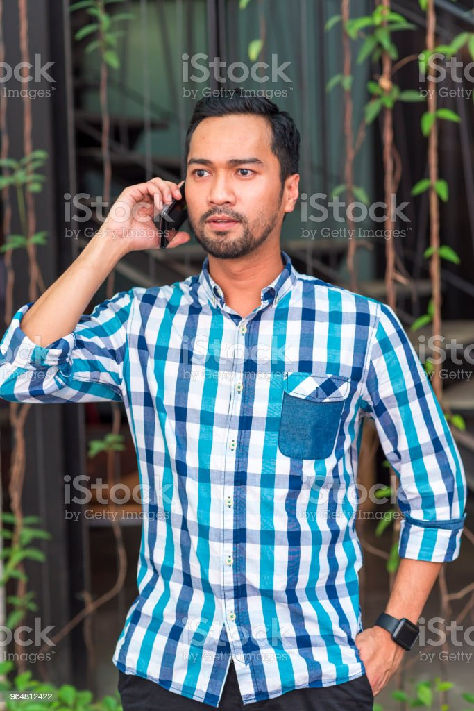 Asian man talking on cell phone royalty-free stock photo