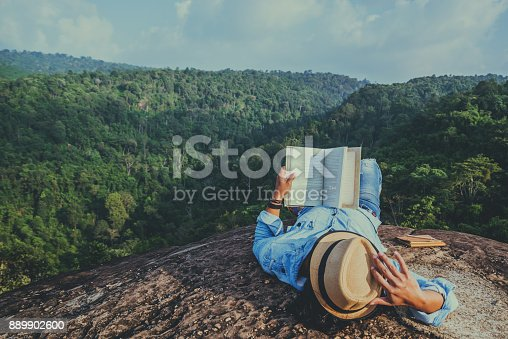 istock Asian man travel relax in the holiday. sleep relax read books on rocky cliffs. On the Moutain. In Thailand 889902600