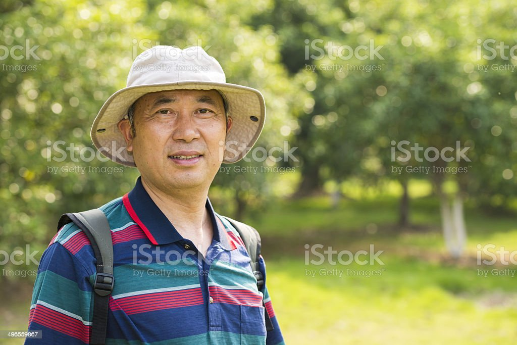 asian man travelling in the forest stock photo