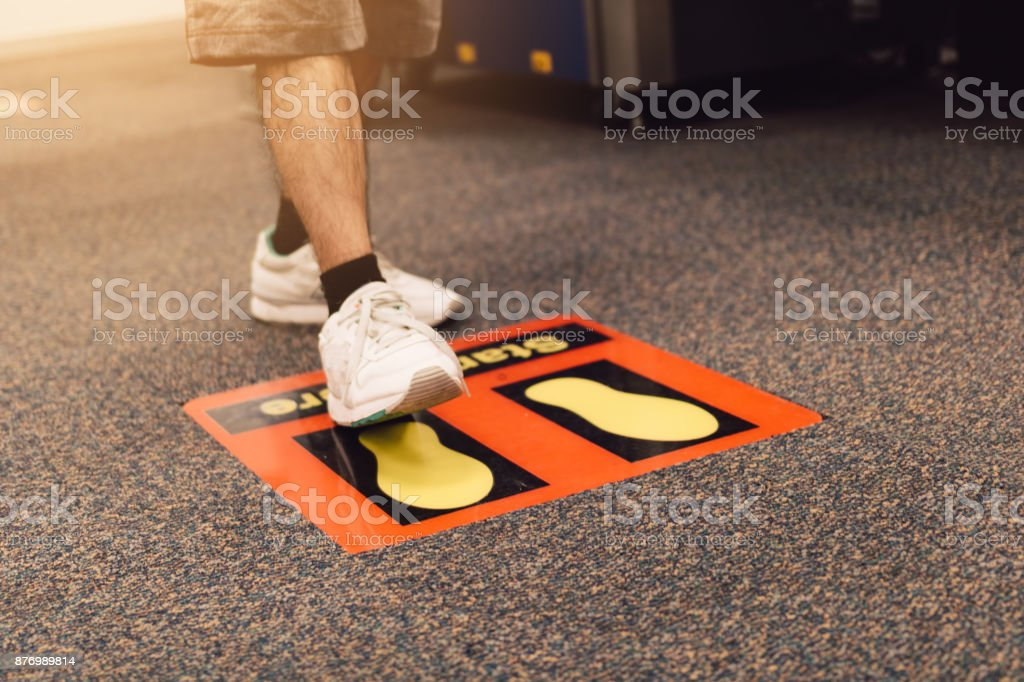 Asian man walking and stop on security check symbol at airport. stock photo