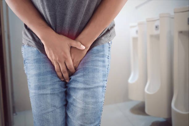 Asian man wants to pee and is holding his bladder. Asian man wants to pee and is holding his bladder. urinary system stock pictures, royalty-free photos & images