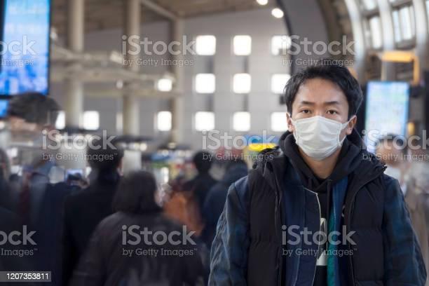 Asian man wearing face mask on the street picture id1207353811?b=1&k=6&m=1207353811&s=612x612&h=894ncxhjmfhzv2ltimyy yoo1dwllvfbtu7ian6bkri=