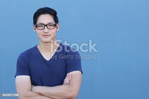 689644378istockphoto Asian man wearing glasses on blue background 640931096
