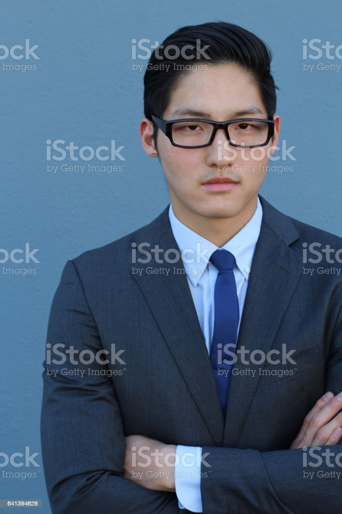 Asian man wearing suit, tie and glasses stock photo
