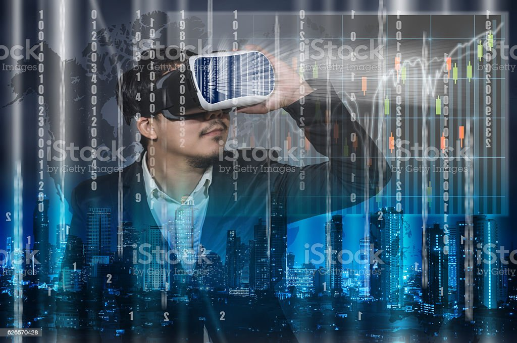 Asian Man wearing virtual reality Looking the digital numeric display stock photo
