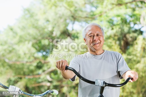 1029243348 istock photo Asian man with bicycle 517185505