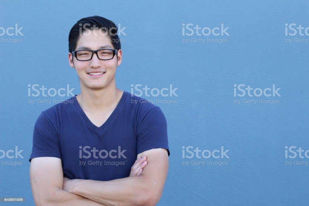 Asian man with glasses crossing his arms stock photo