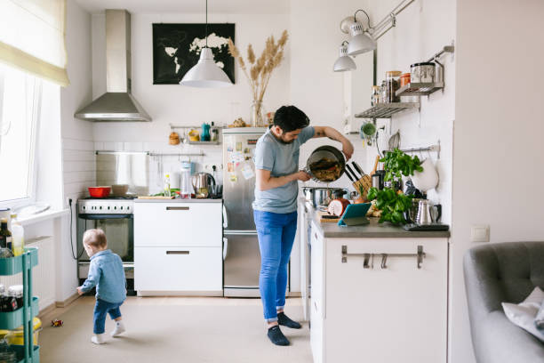 Asian man with his child making ramen soup at home Home cooking series with Japanese family. Making ramen soup. stay at home father stock pictures, royalty-free photos & images