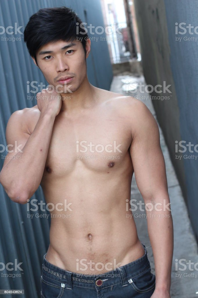 Asian man with muscular torso and v-shape stock photo