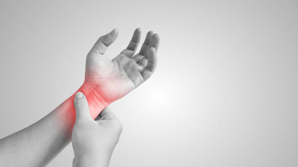 Asian man with painful and inflamed gout on his hand. Asian man with painful and inflamed gout on his hand around the thumb area. gout stock pictures, royalty-free photos & images
