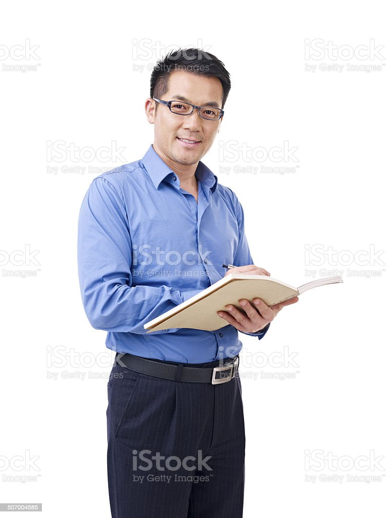 asian man with pen and notebook圖像檔